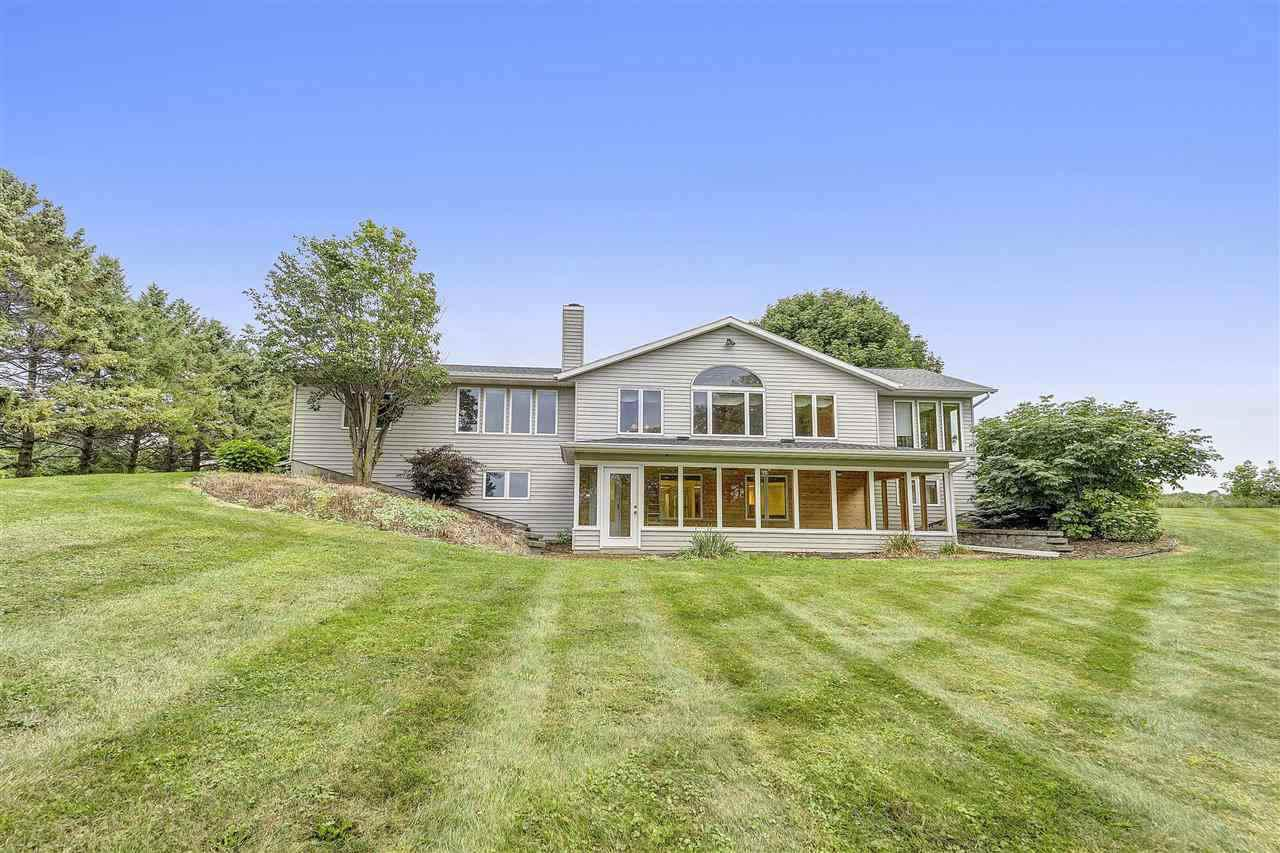 View Single-Family Home For Sale at E831 COUNTY LINE ROAD, Luxemburg, WI