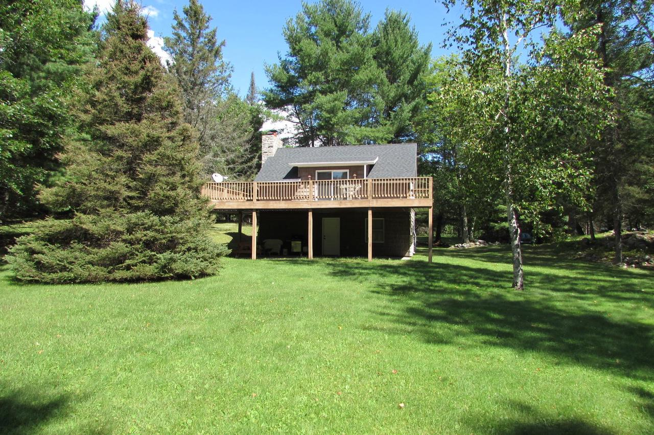 View Single-Family Home For Sale at W8495 Town Corner Lake Rd, Amberg, WI
