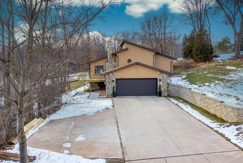 View Single-Family Home For Sale at 311 SANITORIUM ROAD, Kaukauna, WI