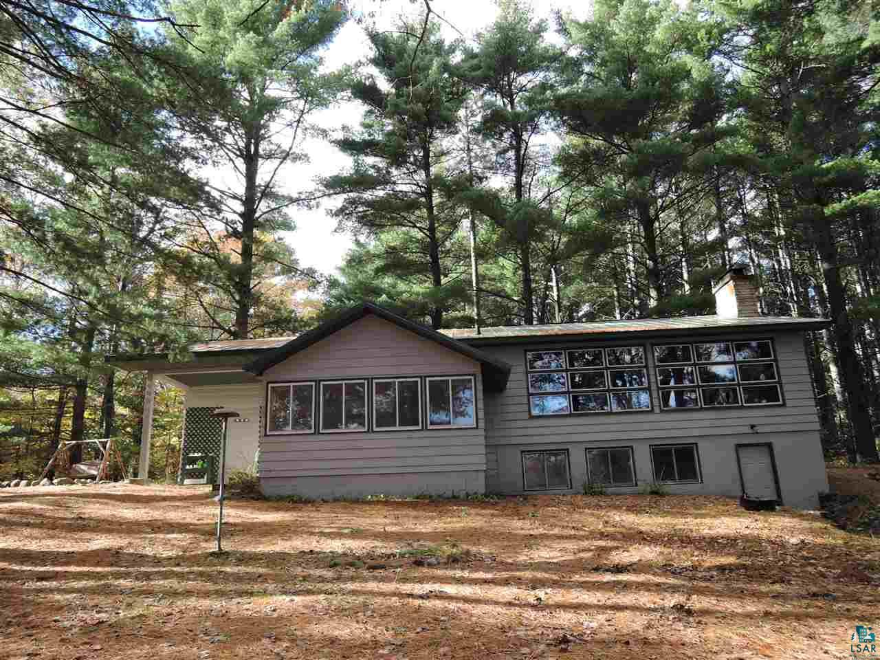 Spacious private year-round or weekend get-away three beds, two baths home on a dead-end road, nestled around towering mature white pine, maple, and oak trees that overlooks 175' waterfrontageof crystal clear & sandy bottom from Muskellunge Lake. Easy access to the Pike Chain of Lakes just one mile down the road to launch your boats, kayaks, or canoes. This lake has a wide variety of Bluegill, Crappies, Bass, Walleye, and of course, Musky fish!  Large sunny updated remodeled kitchen, and lakeside beautiful dining room with tongue & groove ceiling and walls, the perfect place to relax and enjoy the sunrise views and sparkling waters of Musky Lake.  Large living room with natural lighting from tall windows, beamed ceilings, and a stone fireplace. On the lower level, large family room with a beautiful brick wood fireplace and great views from large windows enjoying views of the lake and all kinds of nature, deer, turkeys, and turtles.  A large bonus room for an office or could be a third bedroom without an egress window.  Laundry/Utility room with tons of storage, a second bathroom, and a sauna room with a shower and more storage room.  The brand new, updated full bath near the master bedroom in 2018. New 50 year metal roof installed in 1999. Large mudroom entry with a large deep closet screened-in porch, and a fire pit area to sit around and have great conversations with family and friends.  Two cars detached garage with power and lots of storage room. Updated 200 amp service and new metal roof in 1999, new water heater and boiler system/furnace 2017.  Both bathrooms updated, main floor full bathroom in 2018 and the second bathroom lower level in 2019. Excellent internet service with high-speed fiber optic internet, home landline phone,  premium channels from Norvado. Close to thousands of acres of public land, Chequamegon National Forest, and easy access to the Tri-County Corridor to designated snowmobiling and ATV trails cross country skiing or hiking. Located in th