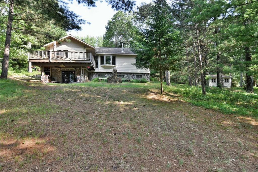 Beautiful lake front property with 250 feet of frontage on Bass Lake. Use as your Northern getaway or use as a vacation rental opportunity. This property has over four acres plus the option to buy lake frontage in 100' foot increments.  Two charming cabins on the property. A two-car garage with a bunk-house attach that hosts a sauna! This property comes fully furnished!