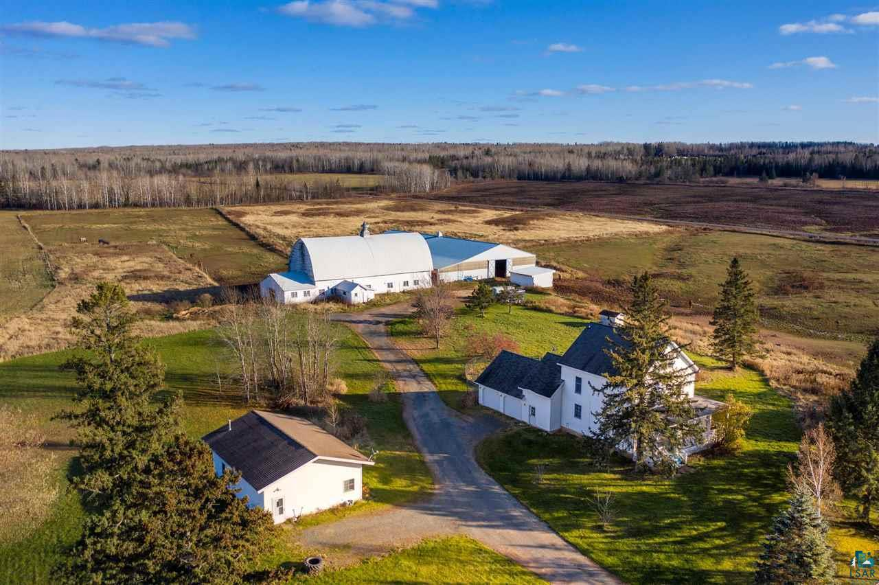 Searching for your own private hobby farm located only 5.5 miles from town? Look no further than this beautiful white farmhouse featuring 28-acres, 5+ bed, 2 full bath and an attached garage. Enjoy picturesque views of the horses running through the pastures on the spacious wrap around porch or relish in the open dining room that showcases tons of natural light and views of most of the property. This home is like living in a Hallmark post card, it offers natural hardwood floors, a newer boiler, and updated plumbing and electrical along with newer Anderson windows. Oh, I forgot to mention NO SEPTIC. City Sewer and Natural Gas are hooked up to both the main house and rental house next door! The neighboring home - 4450 S. Stone Rd is additionally part of this sale and generates rental income. Just a few steps from the house is the 102' x 34' barn with separate electric and water along with 13 large stalls for all your horse?s needs. 20' from the barn/stalls is the 90' x 145' indoor riding arena that hosts local riding clubs and is used for additional hay storage. This one-of-a-kind property has 3 horse pastures with electric fencing and a run-in shed as well. Now is your time to own the country charmed home you?ve always dreamed of! Enjoy private country living with all the amenities of the city. Call today for your own private tour.