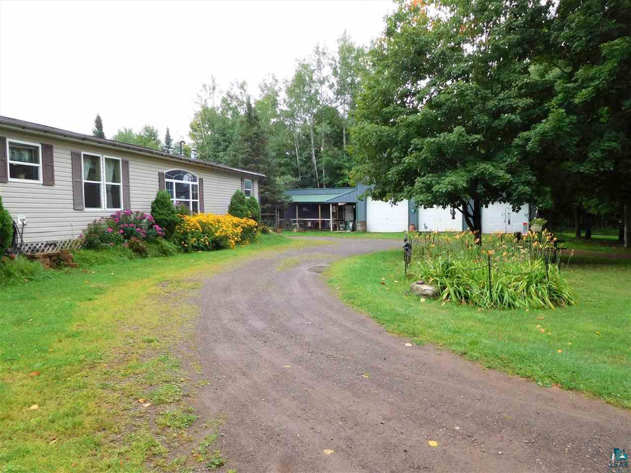 Down the road from Copper Falls, and an easy thirty-minute drive from Ashland (no city traffic or stop & go lights!), you'll love this property that's just under eight acres with a barn, chicken coop, numerous garden areas and trails throughout. The home has been added onto with a shared deck in the center which gives you many options & possibilities. Hobby Farm, Ranch, Air B&B, Offices, Studio Space, Mother-In-Law Suite? Plenty of space to spread out and enjoy two living rooms, kitchen with walk-in pantry, master bedroom with walk-in closet and attached bath with soaking tub, mudrooms, office, main floor laundry and much more. More acreage is available if desired.  The barn has three doors to house vehicles and equipment, a tack room, work room and upstairs storage/hay area.  Rock the evenings away on a rocking chair under the covered porch while the horses saunter by.  Numerous perennials and herbs are here to get your gardening started, come take a look!
