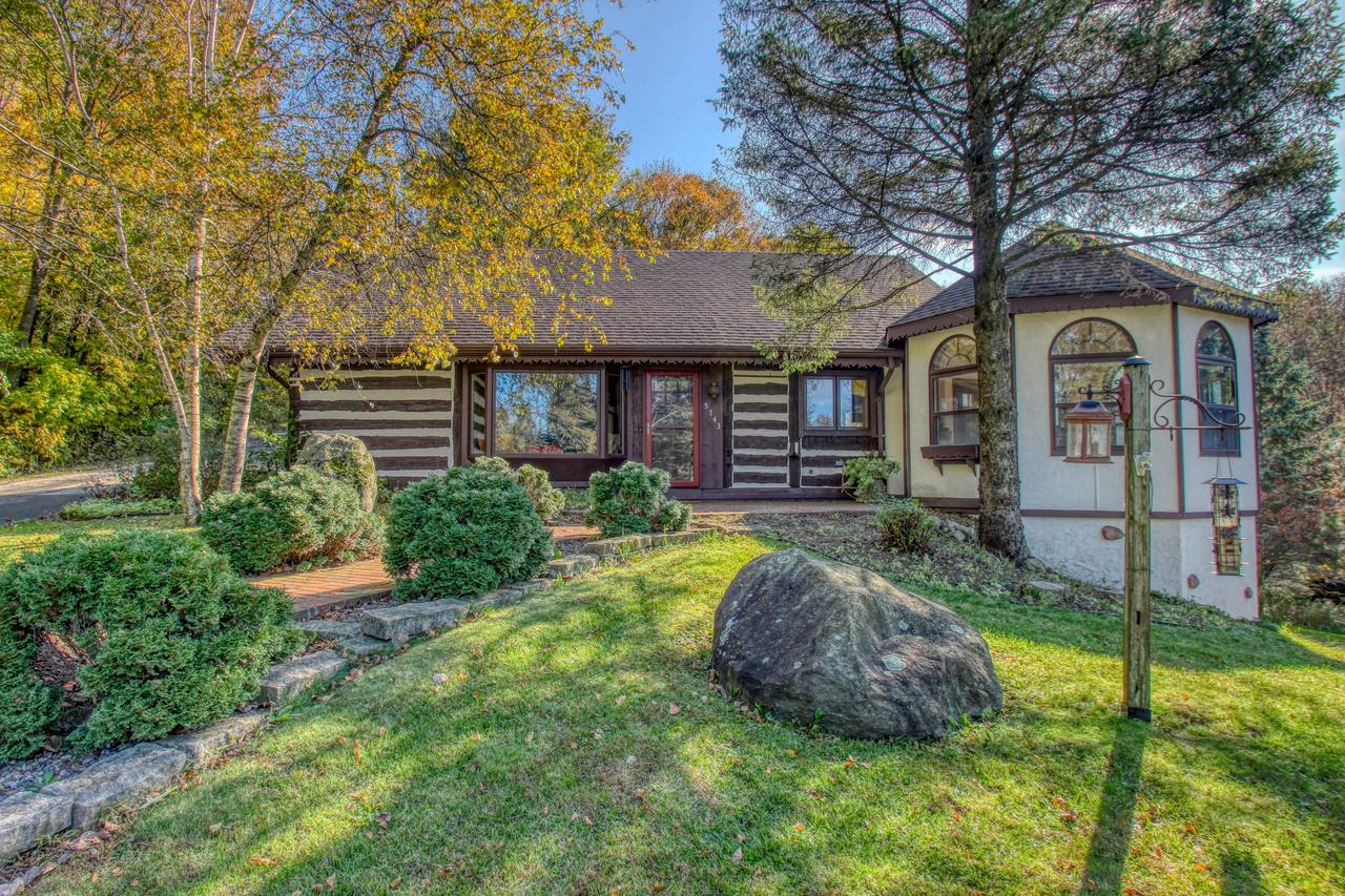 Welcome home to your very own nature preserve on 11+ acres. This handsome log home has the perfect blend of old world craftsmanship & modern conveniences. Gorgeous views from every room w/abundance of wildlife & steps away from the Ice Age trail. The chef's sized kitchen features striking cherry cabinets, granite counters, slate back splash, & refinished HWF's.  The great rm offers soaring ceilings with massive beams & a cozy stone natural fireplace.  The main bath was completely remodeled in 2019 & is simply stunning. The lower level is ready to entertain w/bar, spare room for guests & full walk out. Have large toys? Look no further, an additional 30x60 2 level detached garage/shop lower part insulated & heated. Private pond has its own private well.  This lifestyle opportunity is RARE!