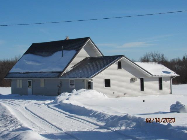 Beautiful, clean 40 acre homestead with all of the following; in floor heat, wood stove, wall unit A/C, three car detached pole shed garage, first floor laundry, open loft and an eat-in kitchen.  Located 7 miles south of Hawkins on dead end road.  Abundance of wildlife!