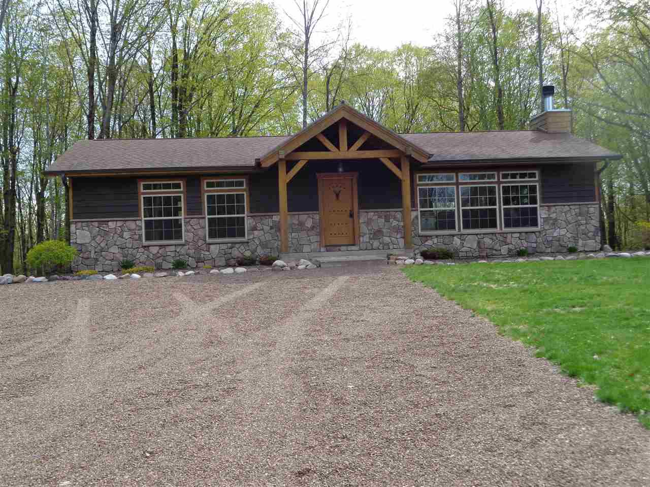 Upscale 3+ bed, 2 bath home or cabin with +/-19.41 wooded acres with a direct border on the National Forest in Perkinstown. Custom kitchen with white ash cabinets, timber frame island and granite countertops. Great room with a wood burning fireplace and vaulted ceilings. Four season room with a bar and access to a deck system. Master suite with a 3/4 bath and double sinks. Main floor laundry room and full bath. Full finished basement with a family room, rec room, bedroom and bonus room.,Professionally landscaped yard, campfire pit and large parking area. Cedar siding, conventional septic, drilled well, forced air lp furnace and central air. Heated 64x40 metal shed built in 2017 with 14' ceilings and 3 overhead doors. Private location near the end of a dead end road and across the road from Kathryn Lake. Stove, refrigerator, microwave, washer, dryer, timber frame island, bar and bar stools are included in the sale price. Furnishings and personal property are negotiable.