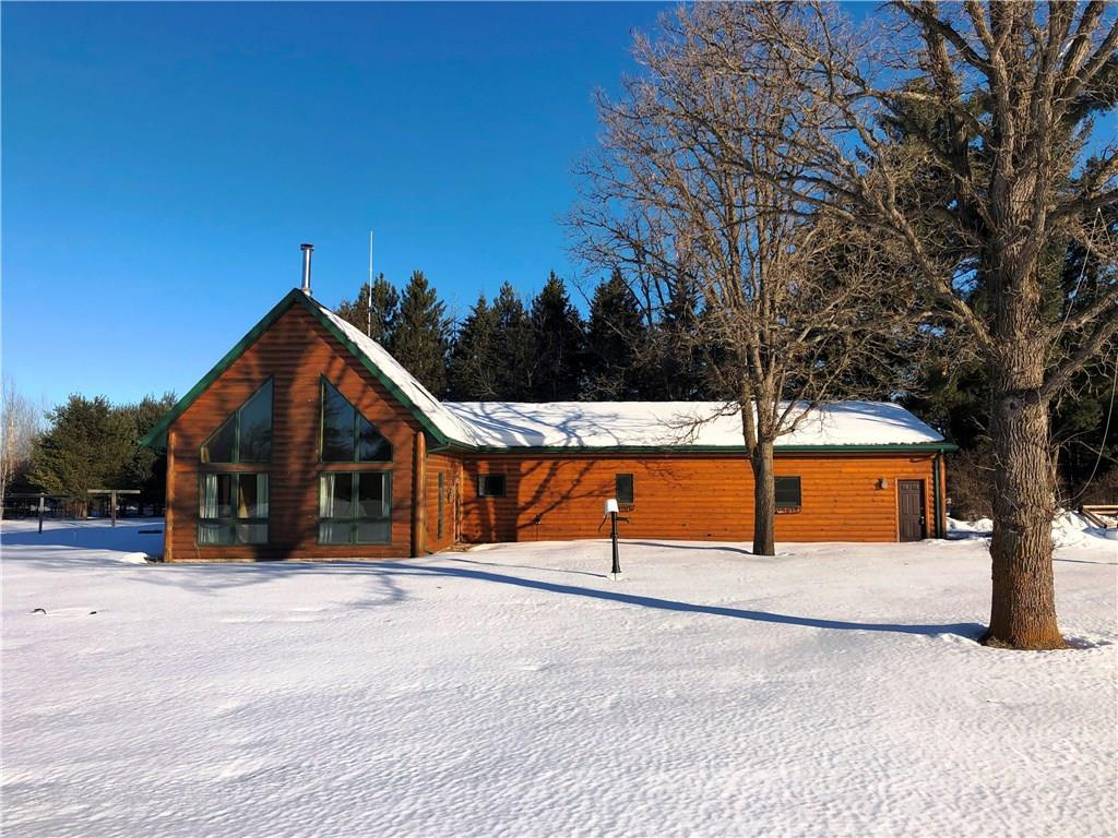 Newer all one-level home on 80 acres; 73 acres of MFL closed and approximately 7-10 acres of fenced open land.  The home features in-floor heat supplied by either an outdoor wood stove or indoor propane boiler plus a free-standing wood burning stove in the great room. Master suite includes jacuzzi tub and 14'x5' walk-in-closet. The dirt floor pole shed is 48'x32'x14' with 14'H x 12'W doors with two horse paddocks. There is a portable 72'x30' greenhouse for those who enjoy gardening. In addition to the drilled well there is a sand-point well to aid in gardening or watering your livestock.  The attached garage is large enough to include a small work-shop. First time offered.