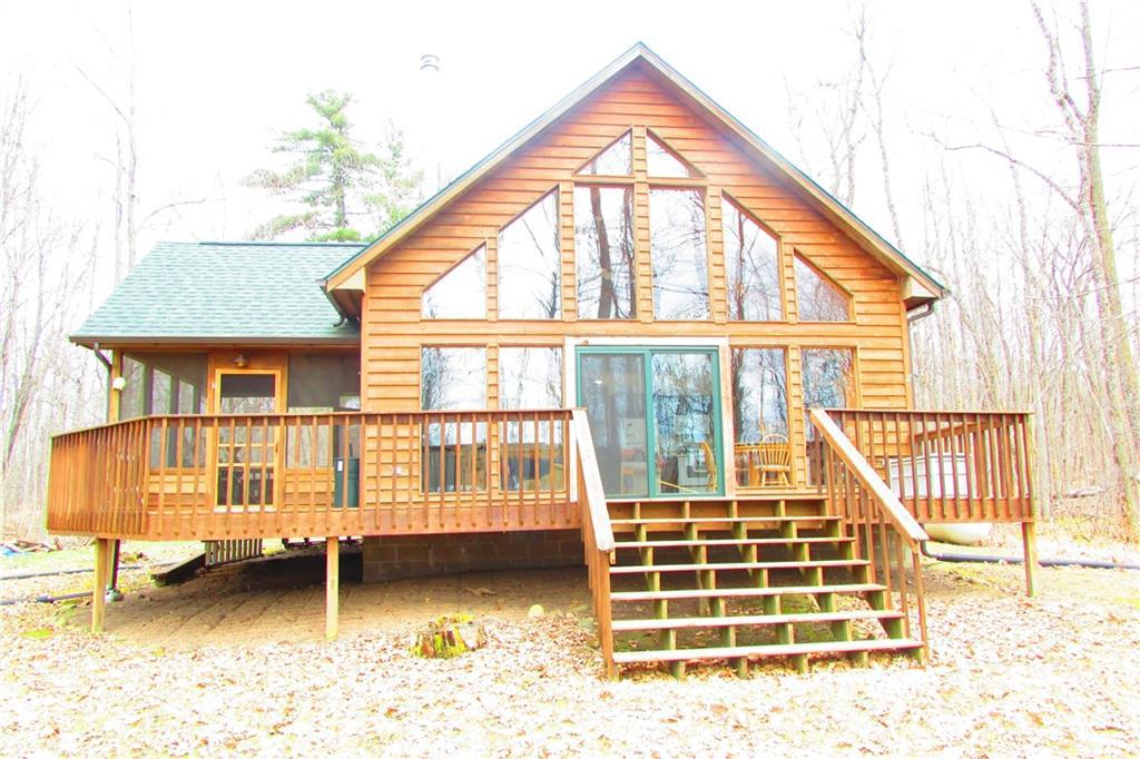 3 BR chalet has a wall of windows for tons of natural light and amazing lake views. There is a spacious loft and open concept great room that leads out to a large lakeside deck. The elevation is low to the waterfront, and the property?s edge runs along the creek for privacy and a nice buffer to the north. The cabin is west facing and has great sunset views. There are hardwood floors and custom cabinetry, and you?ll love the freestanding woodstove for cool nights, and will also enjoy the 14 x 16? screened porch. Potato Lake is 224 acres and 20? deep. You can catch Bass, Northern and Panfish year round. This cabin will make the perfect Northwoods retreat!