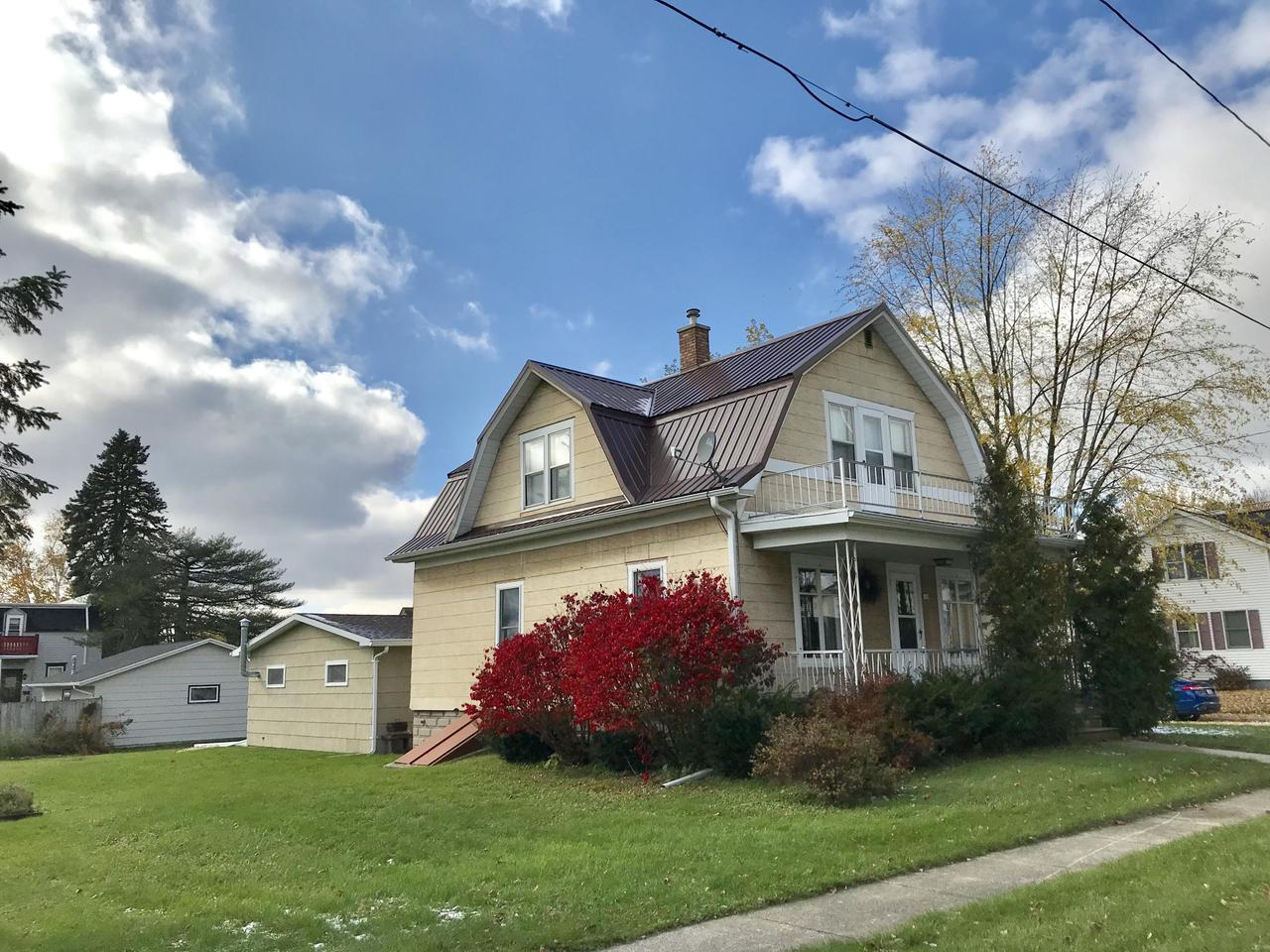 Lovely well maintained 1.5 story home on large lot in Village of Mishicot. Many updates, metal roof (2018), windows, boiler, water heater to name a few. The wood work is beautiful and the rooms spacious. There are 3 BR's, 2 full baths, an office, a bonus room and an awesome rec room great for entertaining. The garage is an attached oversized 2 car with a new parking slab for added parking. There is a nice storage shed too. Lots of storage and central air to boot.