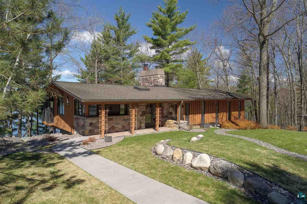 One of a kind, impeccably kept, estate on the Pike Lake chain in Iron River! Nestled on the shores of Hart Lake, with 537? of beautiful sand frontage and crystal-clear water. Two year-round homes on 17 wooded acres with a total of 5 bedrooms, 6 baths and 4 fireplaces. Enjoy captivating westerly facing lake views from nearly every room in both homes! Expansive decks, boathouse, paved circular drive, lawn irrigation, two dock systems, individual septics and wells for each home, three distinct parcels, easy access to hundreds of miles of all season recreational including the CAMBA, Chequamegon Forest and incredible fishing, swimming, boating and just plain relaxing right outside your door. Take a peek?.You will love it!  The Pike Lake Chain in northern Bayfield County, features clear water, great scenery and good fishing. The chain has ten lakes, however five of the biggest lakes account for most of the fishing. There are two public launch sites on the lakes, but all are connected by channels, so you can visit every lake.