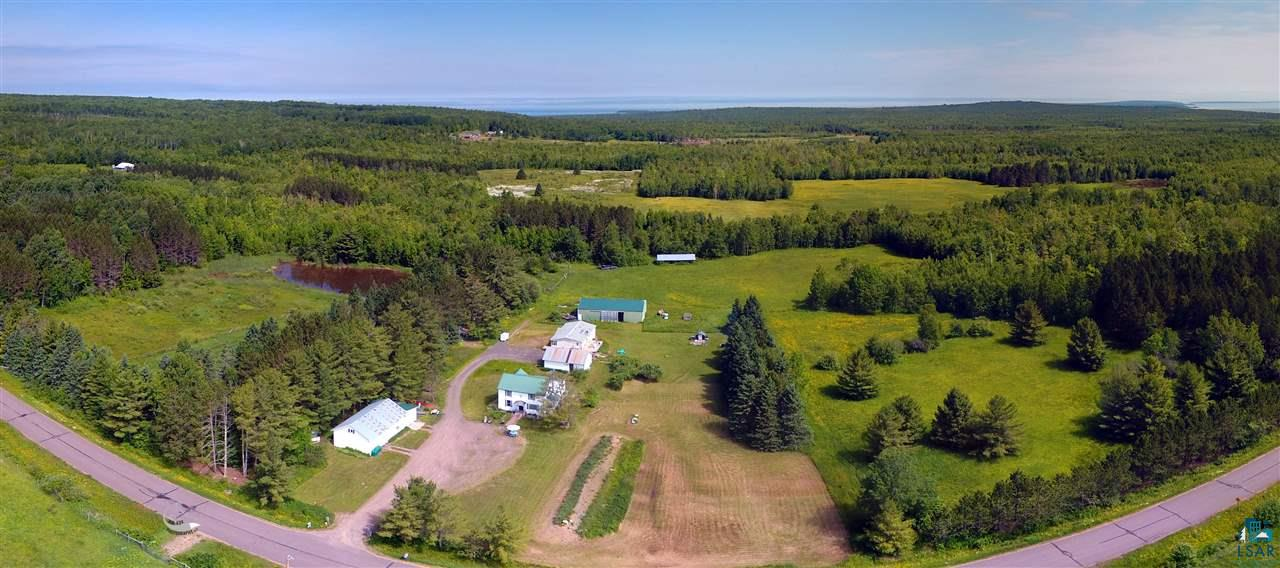 What more could you be looking for? Set on a peaceful 80-acres, this home has everything. 3 bed, 1 bath traditional country home. 3-car garage with workshop and fitness room, shed with humidity control room for storage, pole building, chicken coop, old timber mill and much more! Two large fenced garden areas with electric capabilities. Trails throughout the stunning hardwoods. Great spaces for a hobby farm with outbuildings, chicken coops, fenced areas, and a pond. Fruit galore - apples, pears, raspberries, blueberries and strawberries! Brand new septic system in 2017. Don't miss out on this country charmer and schedule your showing today!