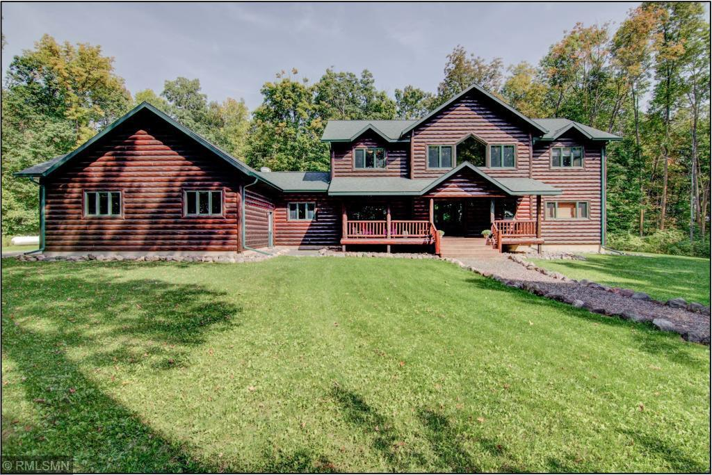 STUNNING newer 5 Bedroom / 5 Bath log sided home tucked back on a 20.5 acre parcel that includes a mixture of woods and open field / meadow. Incredible picture windows, dramatic log finishes, large gourmet kitchen, main floor laundry, incredible master suite, 4 bedrooms located on the upper level, newly finished family room in lower level, heated and insulated 36x28 garage, and in flr heat in basement. This property being sold WITH GATHERING PLACE RESORT listed at $1,650,000 MLS# 5232311. Must see!!
