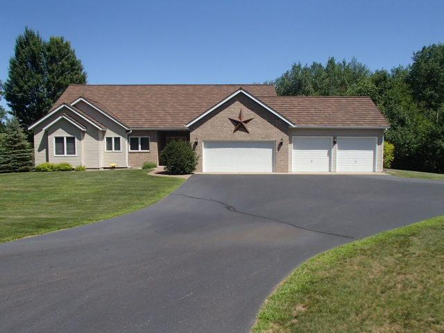 This property is a much see!! From the start, drive up to a black topped winding driveway to a breath taking 4577 SQFT. home where nothing is out of place, from the beamed cathedral ceilings,  a master suite, with jetted bath tub and its own fireplace, a large living room with its brick fireplace provides a wonderful view of the park like yard and walk out deck. The lower level offers a walkout basement, wet bar, family room and hot tub/workout room! With the 50X80 shed and the horse barn there is plenty of room for storage. Located close to Minocqua,Tomahawk, and Rhinelander.