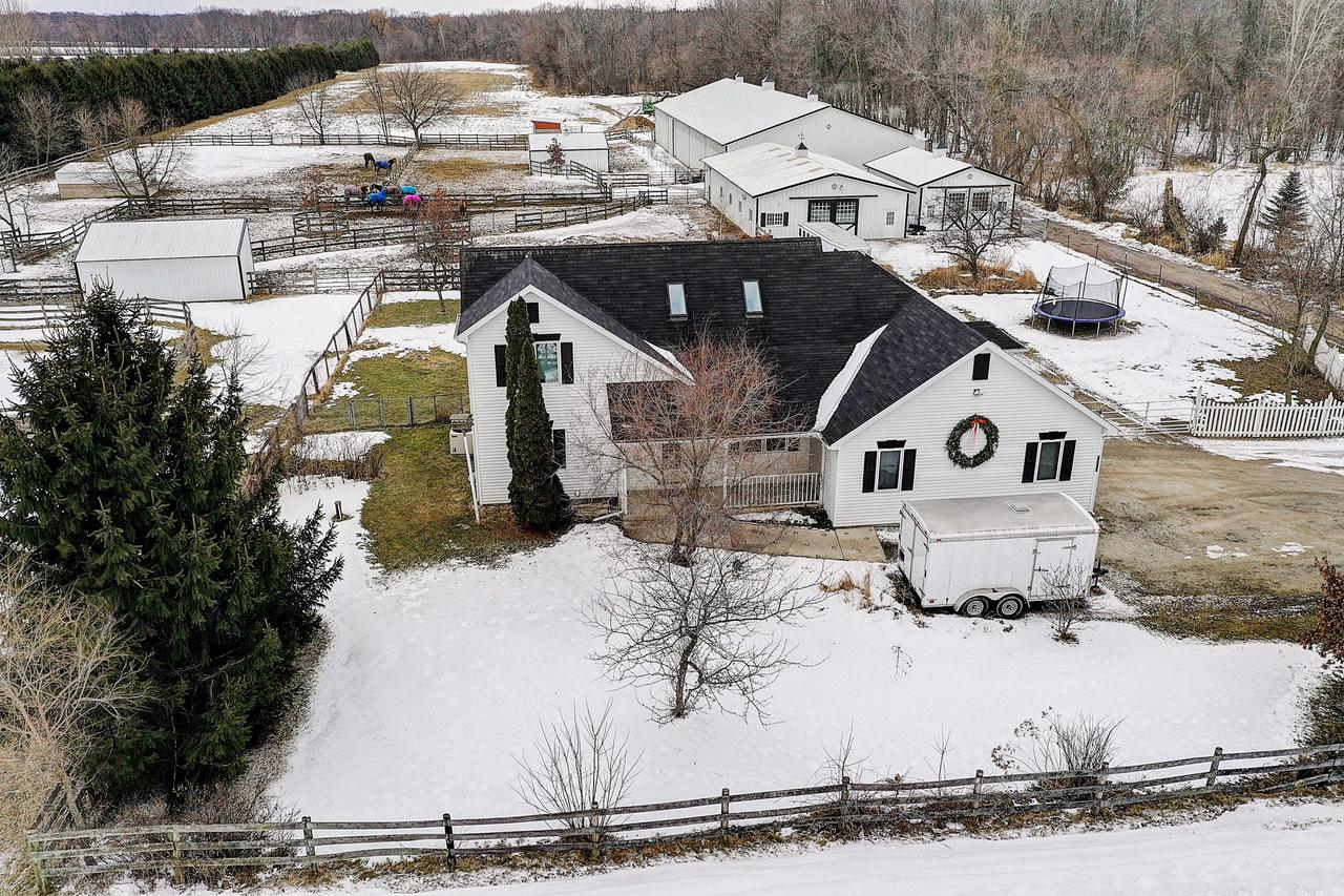 Rare opportunity to own a turn key equestrian farmette on the Caledonia trail system.4 patio doors and loads of windows offer great views of the paddocks and horses. 2 fireplaces,hardwood floors, plus much more.7 stall Morton built barn w/tack room, 60x120 indoor arena, 2 run in sheds, plus 24x36 additional garage. Nelson Waterers, well maintained fencing. Location is excellent! Right on the Root River Trail & next to Caledonia Greenspace Tracks Trail so you can enjoy 60+ miles of riding. Close to I94 and downtown Milwaukee. Claim your space in this unique horsey neighborhood!