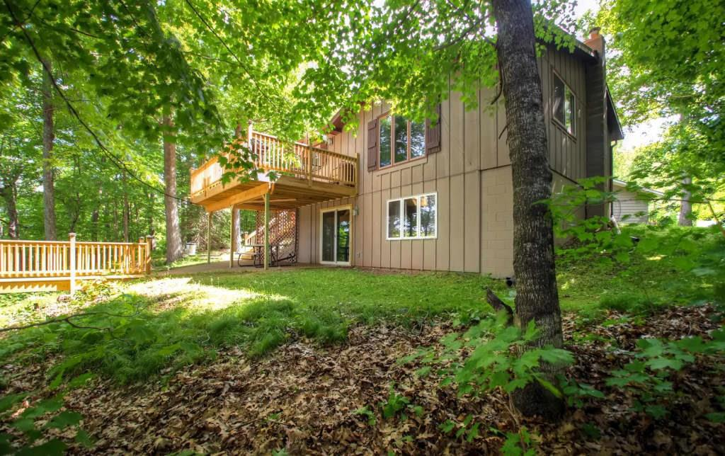 Completely remodeled in 2016 this TURN KEY house is a terrific choice for a family or group of close friends looking for the quintessential lake home! The waterfront location makes outdoor fun the focus with a covered 12x20 foot deck with a gas grill, comfortable outdoor furniture and magnificent birds-eye views of the gorgeous Red Cedar Lake below. On this sprawling property, you'll also find a private dock,outdoor fire pit, and a covered patio, which extends off the basement level of the home. The boathouse and a garage allow for plenty of storage, should you decide to purchase the offered pontoon or use it for water toys and fishing supplies. Inside, you'll find this residence quite spacious and well decorated, featuring an open living area, inviting bedrooms,finished walkout basement,which serves as a recreation room, and all the essential amenities for the utmost comfort! This home is a must see whether you choose to use it as your year round residence or vacation home!