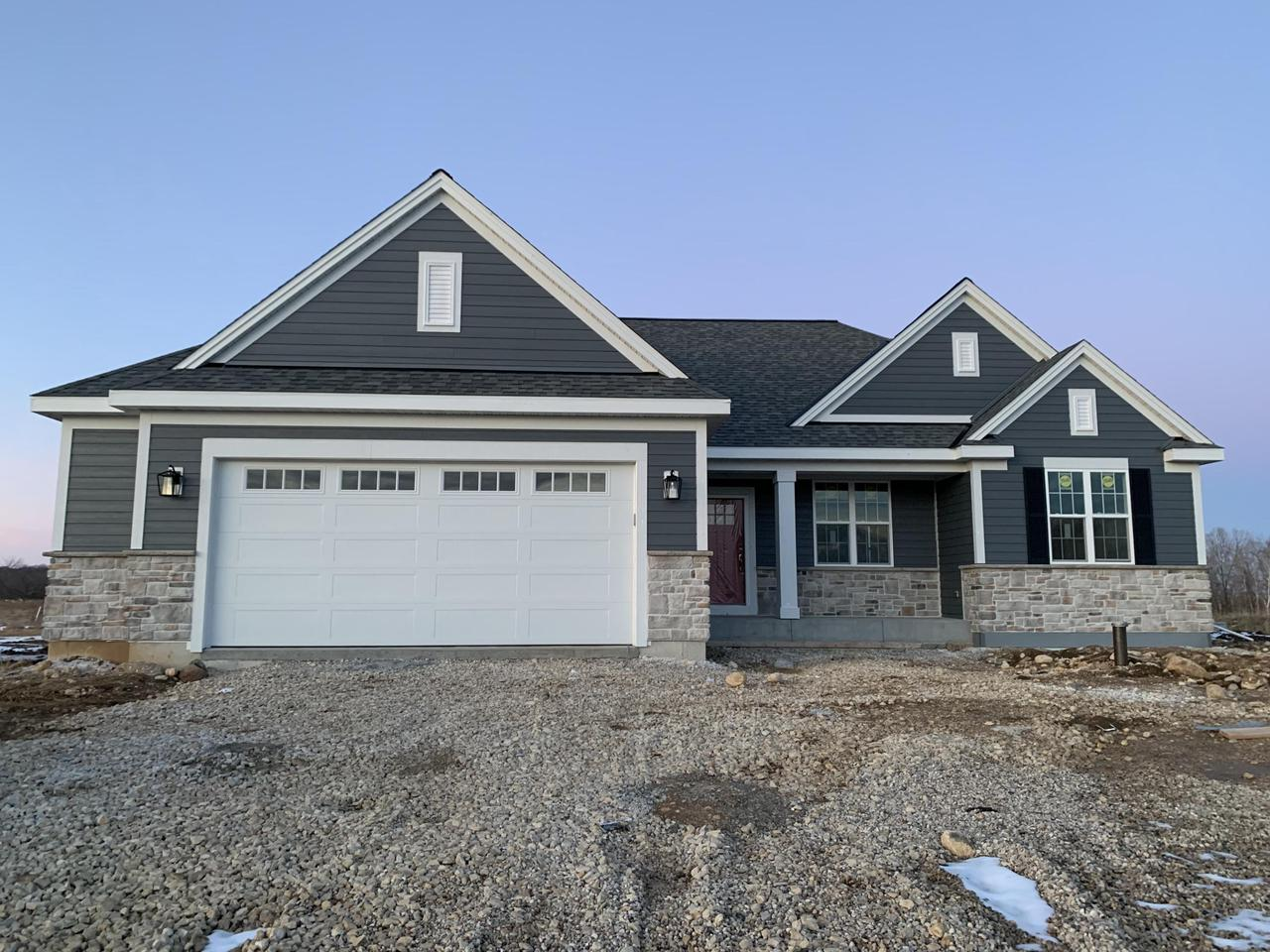 NEW CONSTRUCTION by Stepping Stone Homes. This beautiful ELLINGTON model is located in Slinger in Pleasant Farm Estates subdivision and is in the SLINGER school district! You will find superior quality in this home, 2x6 exterior framing, 8 foot garage door, electric fireplace and more! Lots of upgrades like soft close dovetail cabinetry, quartz/marble counter tops, double sinks in the bathrooms, upgraded flooring throughout and so much more. Don't forget about all the Smart Home Technology, including integrated lighting, door locks, ecobee thermostat, video door bell, Lift Master garage door opener, Samsung Connected Touch Screen Family Hub refrigerator, all of which you can control from your phone!  Located on a large lot with easy access to the highway, perfect for the commuter.