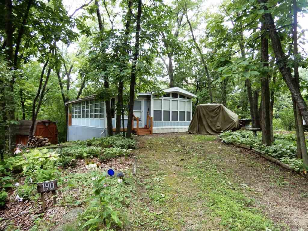 Turn Key Vacation Get away in Rock River Leisure Estates!  1995 Canterbury Park Model.  Clean and Neat with 10' x 26' Sunny Addition! All Furnishings, housewares and appliances are included. Located in a peaceful and quiet area of  the park,  the beautiful natural wooded lot requires low maintenance which allows time for fun! Enjoy the Park amenities to include; 2 pools, fishing pond, tennis courts, shuffleboard, horse shoes, game room, playground, activity nights & more! Rock River & Lake Koshkonong area offer boating for miles, fishing, swimming, and live music all Summer long! Only $500.00 per year Association fee.