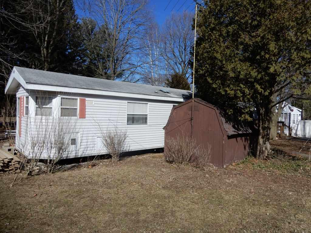 Nice level lot and a great central location in the park ... overlooking the tennis courts and green space. This one bedroom unit has recent updates ... new flooring, paint, bath vanity and toilet and HVAC ductwork. Come relax in the private back yard. Includes most furnishings, patio set, shed and maintenance free decking material. Build your deck or put an addition on the unit. Park amenities include 2 pools, fishing pond, tennis courts, volleyball, shuffleboard, horseshoes, a country store, laundry facilities and so much more! Recreational use only - No year round living.