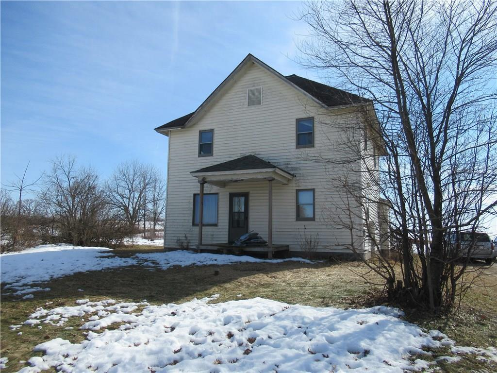 This traditional 2 story farm house sits on top of a knoll overlooking the surrounding farmland. Home features full basement, 4 bedrooms, 1.5 baths, large kitchen, main level bath with laundry and tub with jets, large living room and sun room. New furnace & air conditioner in 2016, new vinyl tile floor in kitchen and bath 2017. Enjoy the wood deck on the south side of the house and large garden area. There is lots of storage in the 40X72 pole shed and 20X40 detached garage. Call for a tour! Other acreage available (see MLS 1528115) just 7 miles away,