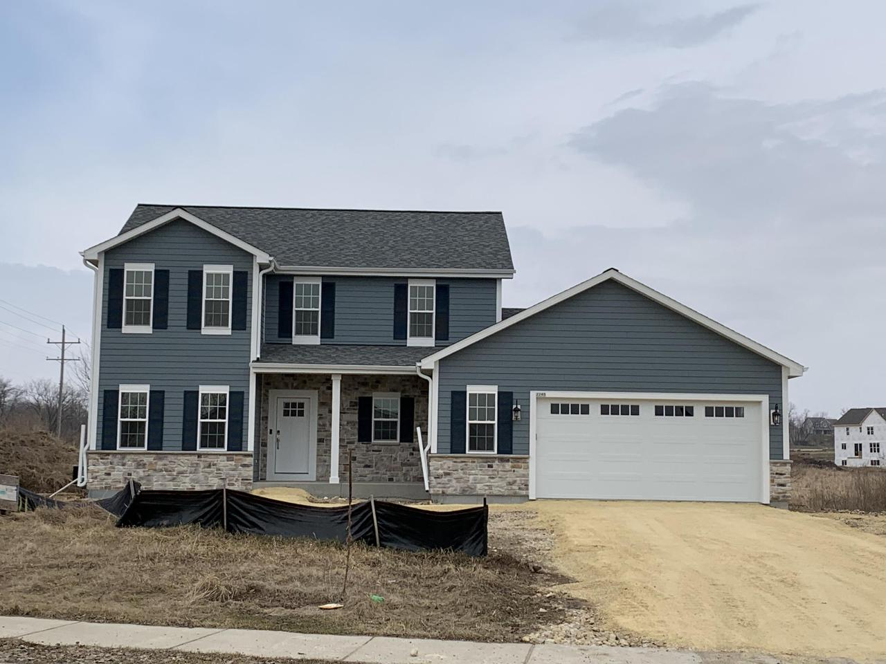 NEW CONSTRUCTION by Stepping Stone homes in the SLINGER SCHOOL DISTRICT! The Camden offers lots of space in an anything but traditional two story home. Spacious MBR w/private MBA & HUGE walk in closet. Open concept kitchen/living room w/fireplace and patio door off dining area. 2x6 exterior framing and upgrades like soft close dovetail cabinetry, quartz/marble counter tops, double sinks in the bathrooms, upgraded flooring, 8 ft GA doors & more! Full sized windows in LL! This home comes equipped with Smart Home Technology, including integrated lighting, door locks, ecobee smart thermostat, video doorbell, Lift Master garage door, all of which you can control from your mobile device.  Smart home technology at it's best.  Large 0.89 acre lot a short distance from 41/45 making commuting simple