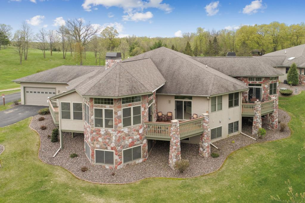 Wow?..This Red Cedar Lake twinhome has it all! If you are looking for the ultimate in luxury and the convenience of a condominium?.look no further. Home features include: oak flooring, 10 foot ceilings, 7 foot doors, 2 fireplaces, walk-in pantry, 1st floor laundry, three season porch, in-floor and forced air heat. Sweeping sunset views, Tag-A-Long Golf Course out your back door, all season recreational trails nearby and 2000+ acres of water for swimming, fishing and relaxing. Condo has a great rental income history.