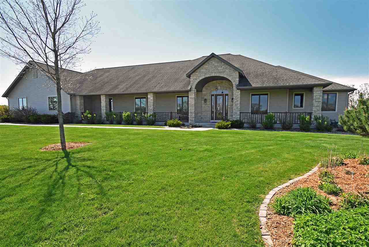 This is a Beautiful sprawling property on 56 Acres in the town of Oregon. Stone Gates Entrance, A Beautiful custom built 5000+ Ranch home. Hardwood fl., Granite tops, upgrades throughout, exp. walkout, screen porch, 4 car att. Garage. Property includes two homes, A 180 x 100 Horse Barn w/ 7 Box Stalls, Heated & AC Tack Room, Lounge with viewing area & kit. area & bathroom, Arena & More! 80 x 50 Hay Barn, fenced pastures, Tillable land, etc. Currently a Horse Farm. (2nd home *6073 Purcell, (40x26) plus a 2 car det. garage also included in the price.) Additional 20 Acres available for $300,000.0.