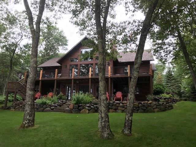 Fantastic luxury lake home on the Minong Flowage! This incredible property features; spacious home, attached & detached garages and blacktop driveway. Gradual slope to the prime sandy swimming beach. One of the best spots on the lake featuring incredible frontage and view. Great attention to detail was made during building and has been VERY well maintained. Some highlights include: hewn log siding, hickory cabinets and flooring, granite counter tops, Marvin Windows & log accents. Quality landscaping and lawn with sprinkler system. Inquire now for details.