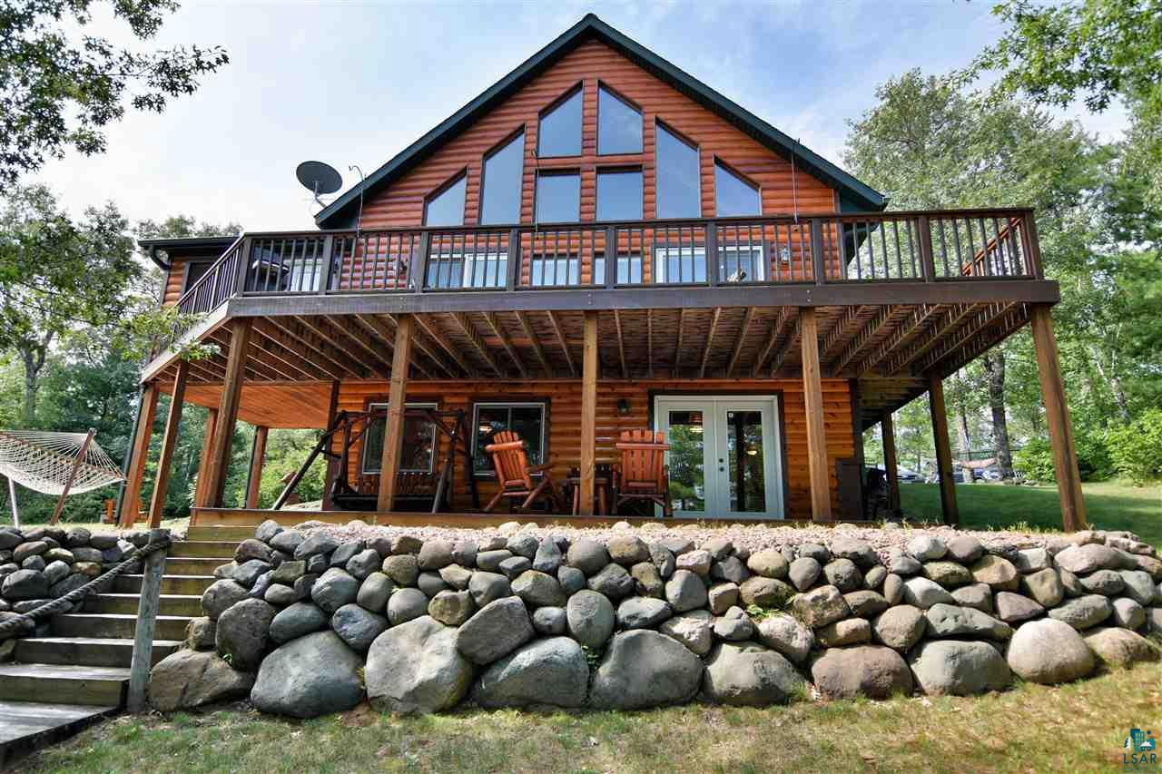 BEAUTIFULLY MAINTAINED LOG CHALET THAT SHINES INSIDE & OUTSIDE SITUATED ON 145? OF SANDY FRONTAGE.  HIGH END FINISHINGS FROM THE WINDOW BOXES & SHUTTERS TO THE GREAT ROOM WITH MAPLE FLOORS & FIELDSTONE FIREPLACE.  3  BEDROOMS PLUS SPACIOUS LOFT.   2 FULL BATHS.  KNOTTY PINE WALLS & CEILINGS.  FULLY FINISHED LOWER LEVEL WITH REC AREA AND PORCELAIN TILE WITH RADIANT IN FLOOR HEAT.  THIS IS A PERFECT CABIN/HOME TO BE ON THE MINONG FLOWAGE. SPECTACULAR LAKE VIEWS.n