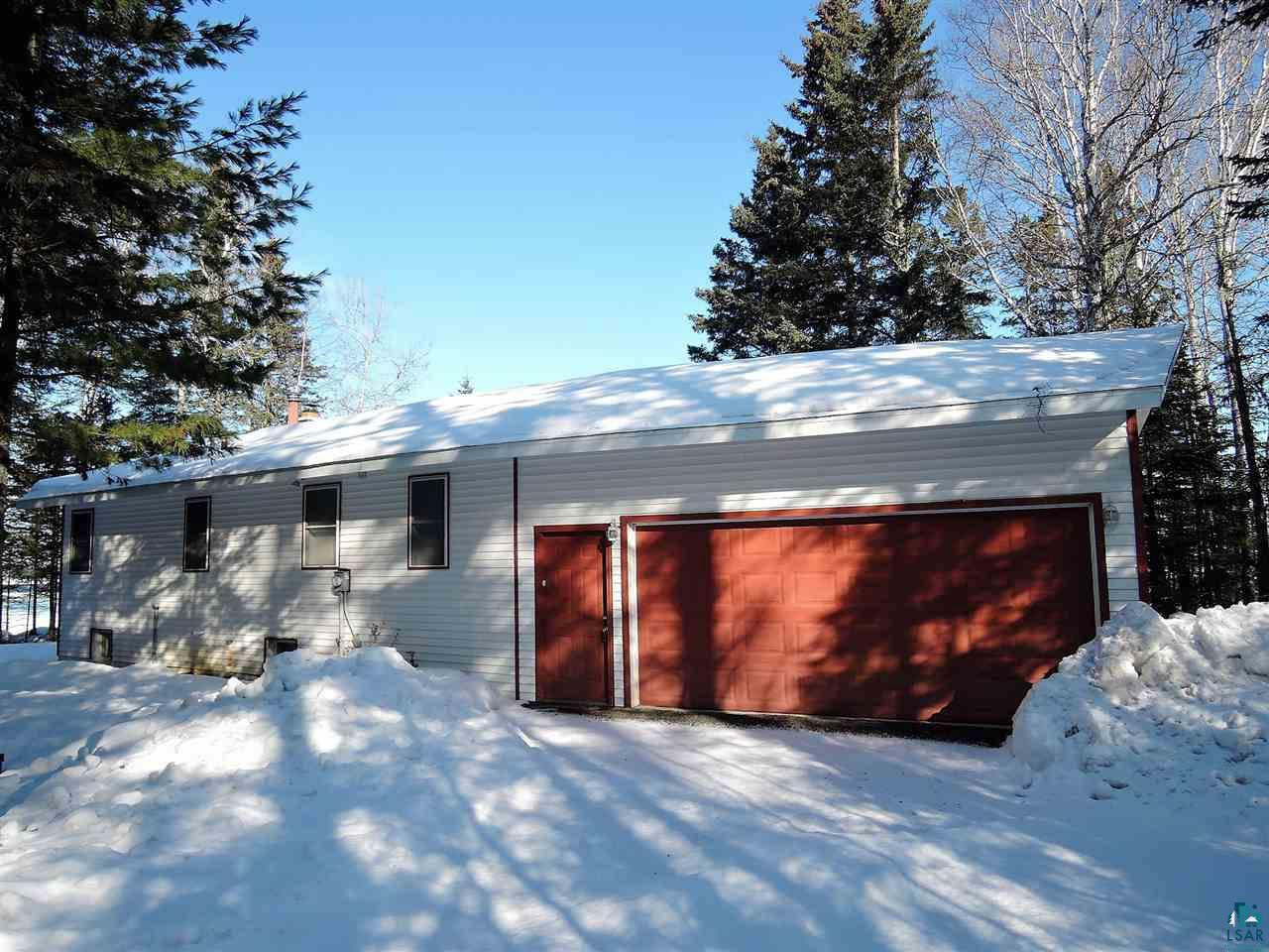 """Great location on the scenic South Shore of Lake Superior. Beautiful 1.8-acre property with mature tall pine and birch trees on 255' of Lake Superior, (with a certified survey). This year-round home features an open concept dining and living room area with energy-efficient windows that lets in plenty of natural light. The living room includes a bay window with picture-like views of Lake Superior and beautiful bookcases surrounding a wood fireplace to relax with a cozy fire or read a book. There are also great views from the dining room and kitchen while you are cooking or washing dishes, with ample counter top and cupboard space. The dining room leads out to a deck overlooking the Lake, where you can sit and have your morning coffee or entertain your family and friends.  There are two spacious bedrooms as well as a possible 3rd bedroom/office/workout room in the basement. The second bedroom is arranged as a Den/Guest room with a hideaway bed. In the utility room, there is a washer and dryer, along with plenty of storage and pantry. There is also a cute three-season cottage with power and lights for extra room for guests to sleep or just an area for relaxing listening to the waves and watch stunning Lake Superior sunset views. This property boasts a high-speed, fiber-optic, wireless internet to watch premium TV channels and a landline phone service provided by Norvado. The basement has a newer sump pump, water softener, forced air furnace, water heater, and three egress windows so you can have a possible third bedroom or nice family room for additional space if needed. Maintenance-free vinyl siding, energy-efficient newer windows, and roof. Low cost for utilities with a conventional septic system and private well with a  water softener unit. Activities for your family in the summer include a seven-mile peninsula offering a beach, camping, boat launch with a small sandy beach area near the tip of Bark Point, and """"Bark Bay Slough"""" Natural Area (522 acres).  There is al"""