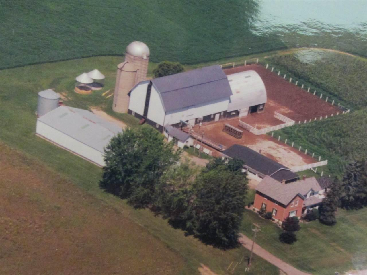 Rare find -  Large 5 bedroom country home, with 10' x 11' sitting room and a finished basement.  45' x 112' steel pole building, 40' x 80' barn with 40' x 50' addition, 2 corn cribs, grain bin, 2 silos, milk house, tool shed, 36' x 52' four-car garage, with 10' x 26' screened patio.  73 acres available,  great opportunity to live where you have a business, or farm it.  Property will not be divided at this time.