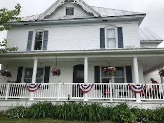 14 acre hobby farm. Restored 5 bedroom brick farmhouse. 2 full bathrooms, one up and one down. Beautiful hardwood floors. 2 additional rooms that could be used as a den/office. Wrap around front porch. Shed used as a horse barn. Land is tillable.