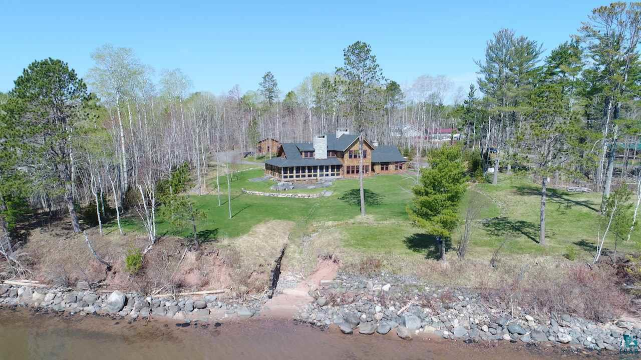Built in 2015, this high end custom built home combines modern features with a charming lodge-like feel and embraces gorgeous Lake Superior views from almost every room!  Flooring and beams are reclaimed lumber from the 1800's.  Custom cabinetry throughout.  Beautiful Bluestone counters and vanity tops.  Wood and gas fire places.  High end stainless appliances.  Top notch audio/visual Sonos sound system and all electronics included w/purchase.  Sweet wrap around screened porch  w/great views, and built in Wolf gas grill.  Huge basement with fitness room, sauna, 3/4 bath and plenty of storage.  Located halfway between Ashland and Washburn, and just 20 minutes to Bayfield.  Make this YOUR home, lodge, family/business retreat... on the biggest lake in the world!