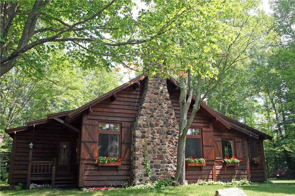 Price Reduced! Two remarkable 1930?s Norwegian Craftsman built lodges, excellently maintained, 1800 ft. Upper St. Croix Lake w/ boathouse, docks, garage. BR, BA, SQ Ft. are combined details. St. Croix & Brule River accessible, 40 min to Duluth/Superior. Main Lodge: California-hewn cedar log; cedar interior, beamed ceiling, built-ins, DR/kitchen, 2 bedrooms + loft, 1 BA. Basement: washer/dryer, cedar cabinetry. Chalet Lodge: Stone & cedar exterior. 1st floor 2 stall garage & woodshop. 2nd floor cedar interior, open floor plan, beamed ceiling, skylights, screened balcony, DR/kitchen. 2 BR, walk-in closets. Full bath. Both have massive stone fireplaces. Fully furnished. Beautiful Cabinetry. Sleep 14+. Impeccable vintage. Vacant lot (appr 1 acre) north of 11477 Ossmann Rd is Subject to Right of First Refusal