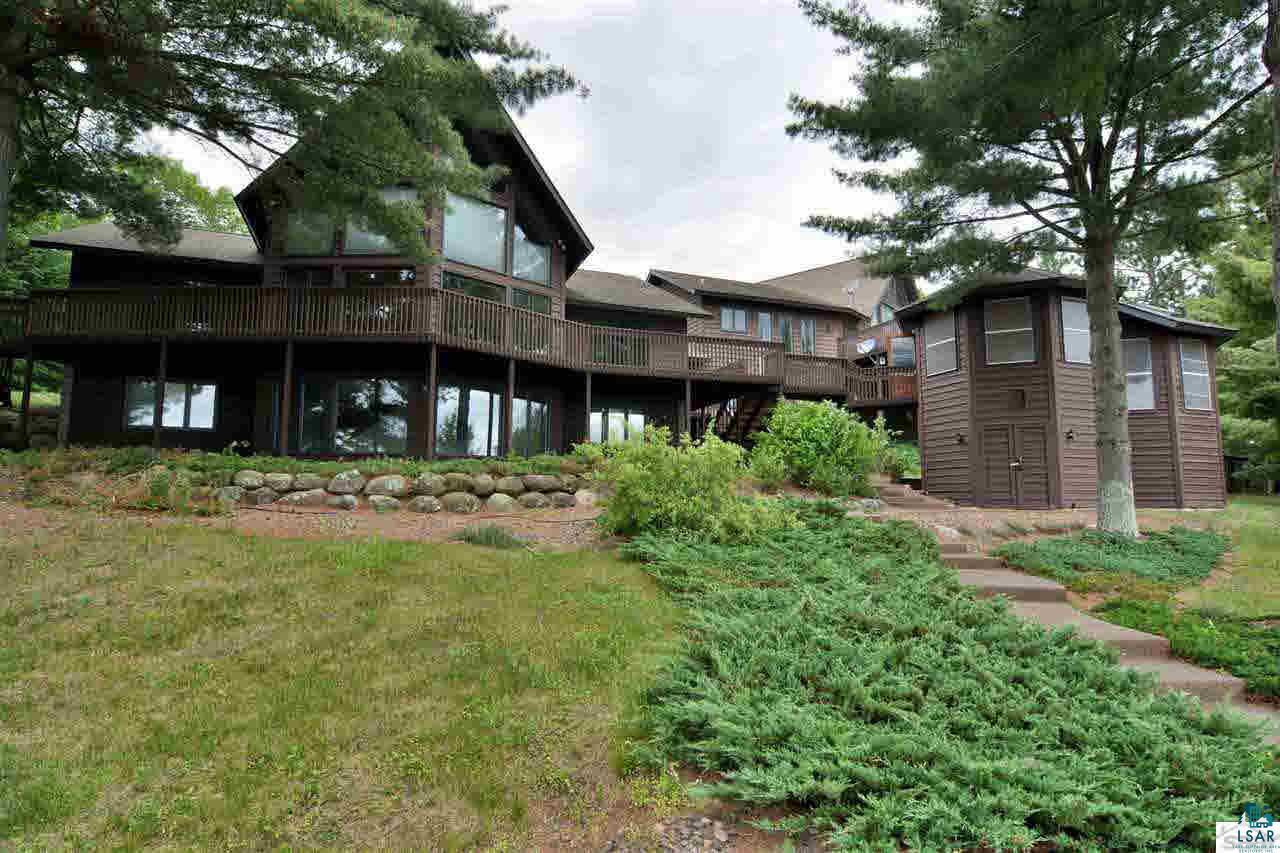"""This is a one-of-a-kind Northwoods home or retreat. It has the perfect elevation and amazing views of Lake Nancy from its very large deck. It is the perfect place for entertaining! Plenty of lake frontage with a nice, sandy swimming beach. It has all main-level living, gorgeously constructed vaulted ceilings, and a phenomenal view of the lake from the master bedroom. Plenty of guest bedrooms with access to their own kitchen. This Nancy Lake """"lodge"""" is the perfect place to enjoy Northern WI!"""