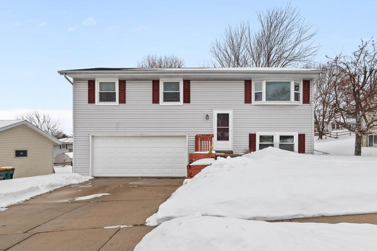 Cozy & well-maintained 3 Bedroom, 2 Bath home with updates to main floor bathroom, flooring in main living areas & some windows. Partially exposed lower level with family room and 2nd Full Bath! Close to shopping & neighborhood park. Convenient location for easy commute. Motivated Seller, Call today!