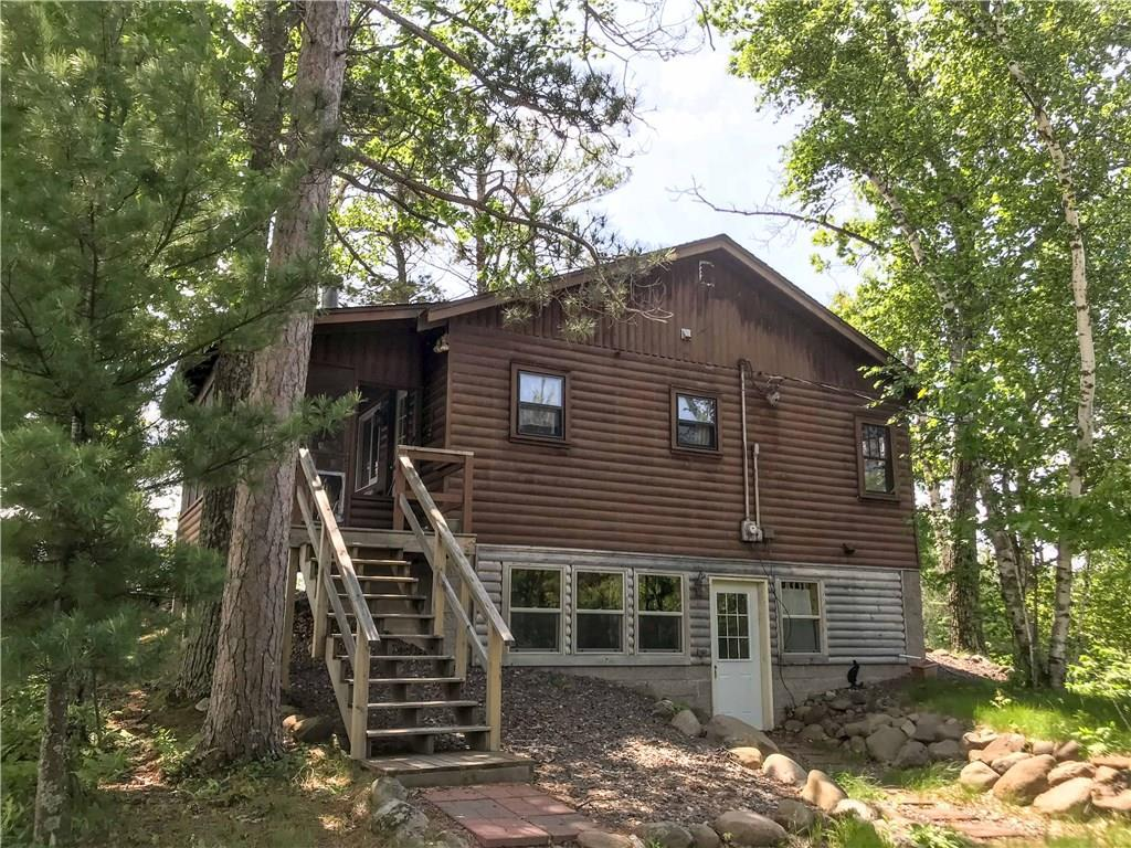 This pleasant cabin is on a peninsula point allowing for extreme privacy. Approximately 800 feet of low to moderate elevation shoreline with hard sand bottom and southwest exposure on beautiful Grindstone Lake. Enjoy the panoramic views from the screened porch. Cozy up with a good book around the vintage stone fireplace. The cabin has been a rental investment for the current owner. According to owner an additional three lots may be developed on this parcel. Seller is a licensed WI real estate agent.