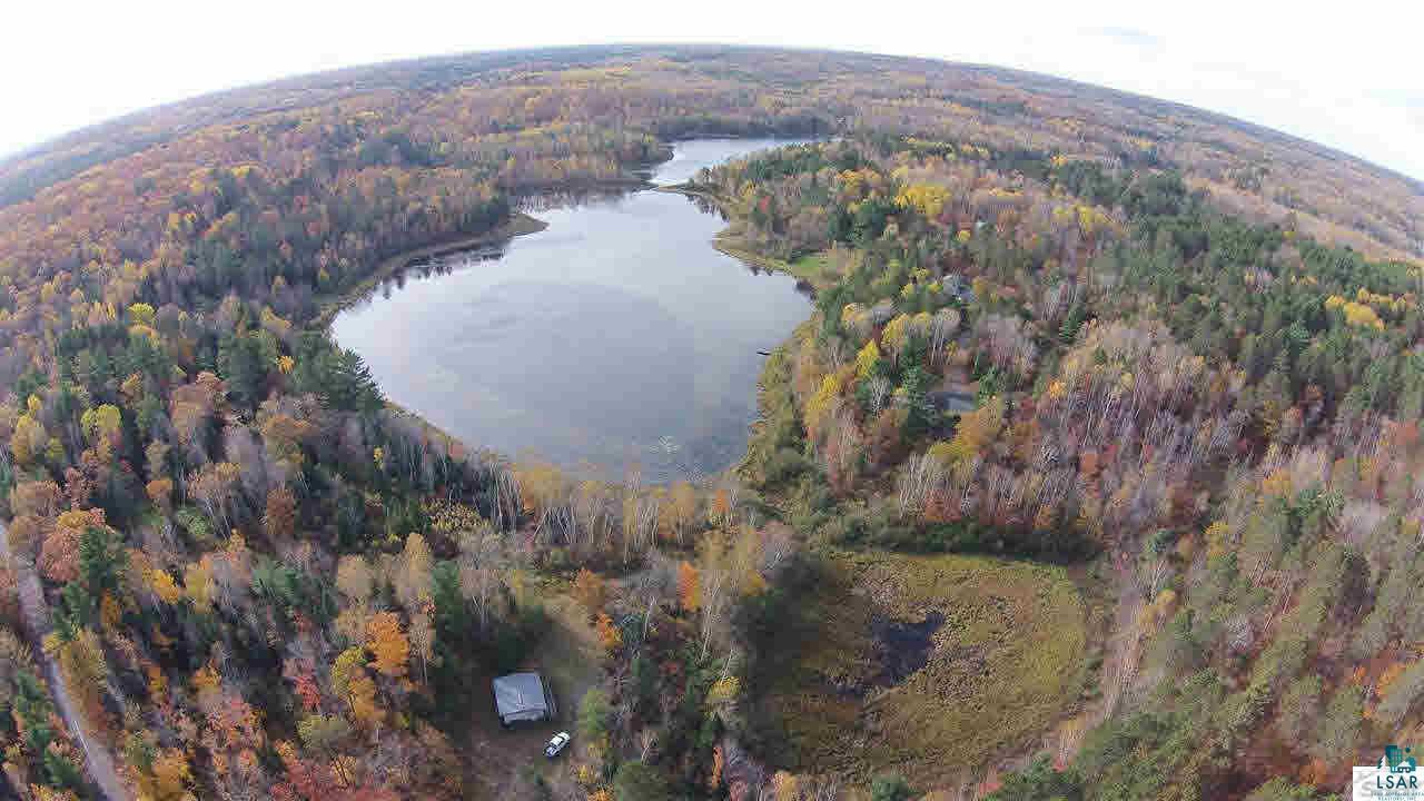 One of the best large 237.859 acre wooded parcels adjacent to public land ever available in Bayfield County. Frontage on Spider Lake with surveyed parcels that could be sold separately. This parcel is fully timbered with 3 miles of groomed trails adjacent to the Tri County Corridor for snowmobiling, four wheeling, running and walking. This property is abundant with wildlife and also has a cabin on the lake with two bedrooms, 1 bath, with a well and conventional septic. There has been trophy whitetail taken off this property over the years.