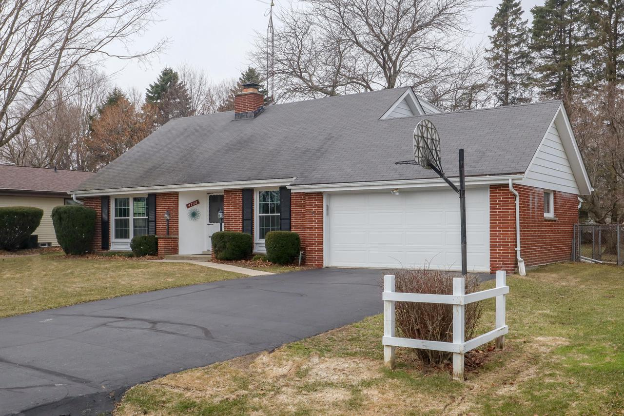 SMART HOME with WIFI thermostat, garage door opener & ''RING'' doorbell, is a 4 bedroom BRICK CAPE COD. On the main floor you will find a spacious living room, formal din.rm., kitchen w/updated cabinets & countertops, casual dining area, family room w/gas fireplace, full updated bath & a 4 season sunroom off the back. 1st floor BR currently has stackable washer & dryer for convenience & can double as office/laundry room or 1ST FLOOR MASTER. Chairlift leads to the second story where you'll find 3 more BRs w/HARD WOOD FLOORS & a full updated bath. Basement has finished game room, water filtration system & dehumidifier. Backyard includes shed & a concrete dog pen. Per sellers, ROOF about 10yrs; windows replaced about 3yrs ago; kitchen appliances are newer. Includes a BACK UP GENERATOR.