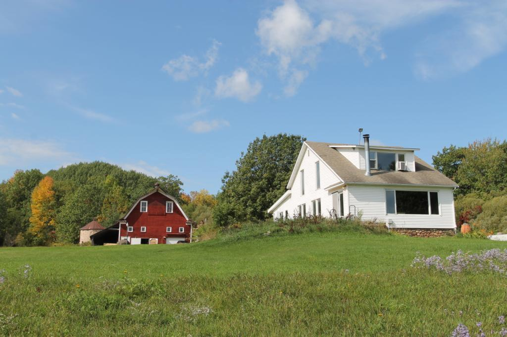 Truly a one of a kind property in Bayfield, WI. Turn of century farmhouse and barn with Lake Superior frontage. Approximately 25 acres with panoramic Lake Superior views. Original barn with Rock Silo. Apple orchard and trail access to the sand beach. Home features 3 bedrooms, 1 1/2 baths. The opportunities for this property are endless.