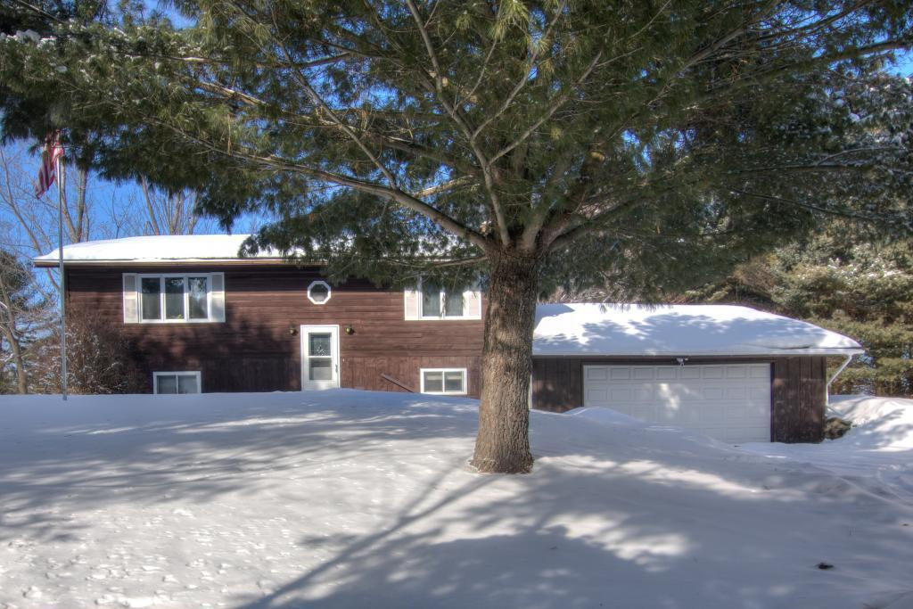Welcome to this Amery home on 5+ acres.  When entering you are welcomed with plenty of natural light from the large windows in the upper level. The upper level has a nice flow from the living room to kitchen and French doors to the deck outside.  There is also the owner's suite with private bath on the upper level along with another bedroom.  Moving to the walk out, lower level there are 2 more bedrooms, a family room and laundry room.  There is a huge, two story, detached garage/rec room in need of just a few finishing touches. All of this on beautifully wooded property with mature trees and plenty of wildlife to watch from the privacy of your own home.  So many updates come to see them all! Call today to take a look!