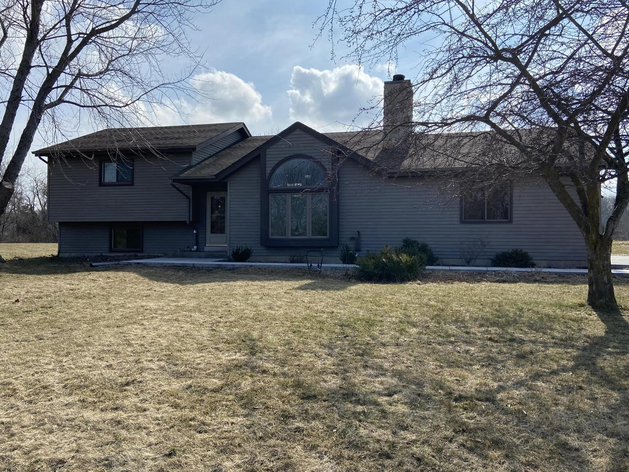 Located in Whispering Hills of Waubeesee Subdivision just off the shores of Waubeesee Lake.  House sits on a quiet cul-de-sac.  There is a partial view of the lake from the deck just off the kitchen. Open concept design, kitchen and dinette overlook living room. Features include new concrete driveway, patio and sidewalk.  All carpeting has been replaced. New well tank and control panel. The upper level has master and second bedroom, full bath along with kitchen and dinette. Main level has living room with natural fireplace. Lower level has third bedroom along with family room , full bath and large laundry room.