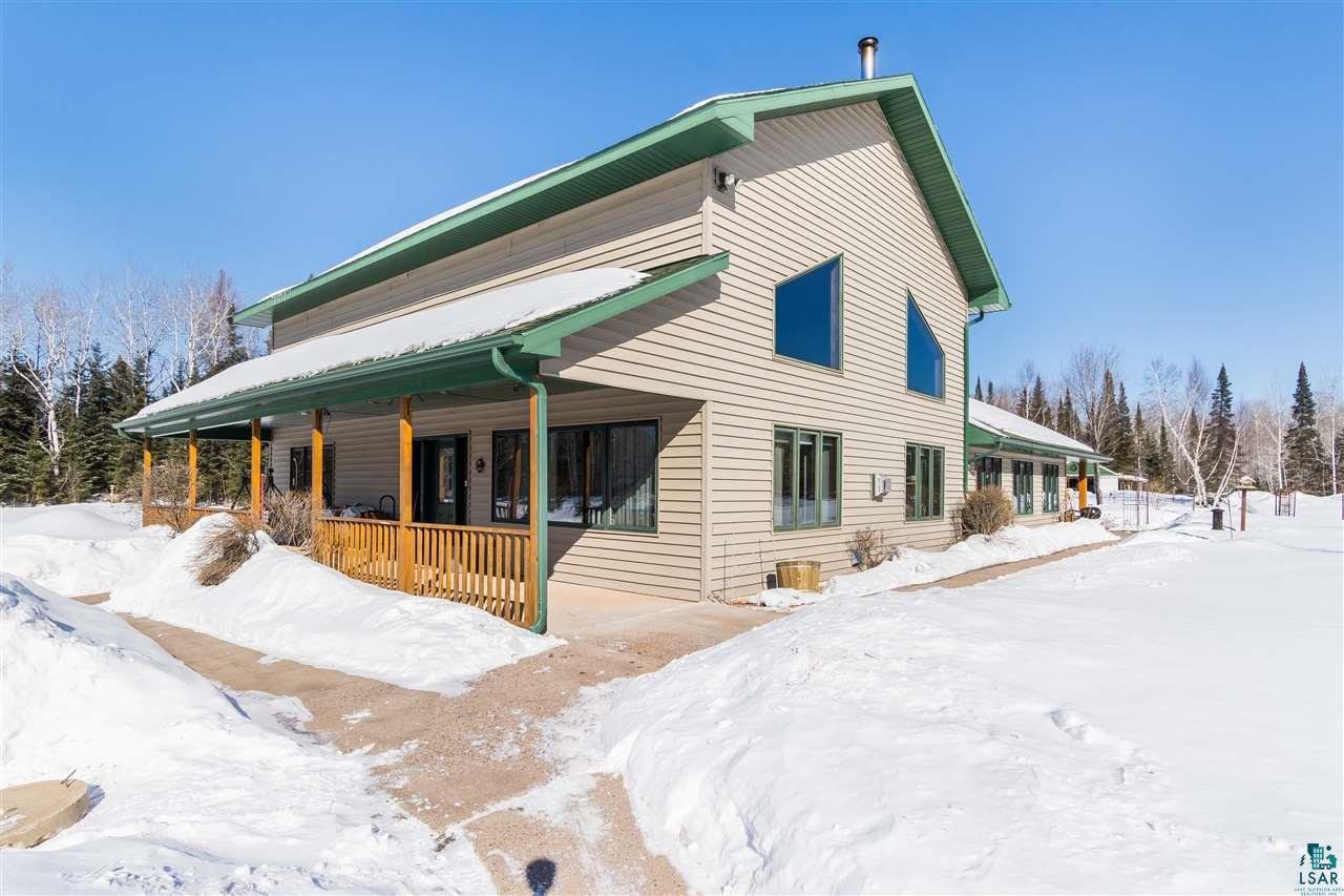 Here is a beautiful home nestled in a private 10 wooded parcel just 17 miles from Downtown Duluth just south of Superior!  You won't find many like this custom built home coming on the market, so set an appointment to take a peek!  Just over 3,000 finished square feet, you will have it all including high vaulted tongue and groove ceilings, a wonderful loft that overlooks the exposed brick fireplace and sitting area, a great room with 600 square feet, including a second kitchen/bar area, great TV and rec area, with windows all around you that provide spectacular views of the property.  Both bathrooms have been completely remodeled within the past few years, and the master features a wonderful walk-in shower with intricate tile work and plenty of natural light.  The Master itself is very roomy with a gas fireplace and plenty of closet space.  The grounds include a 24X30 garage, 24x24 pole barn, a 14x14 overhang with a slab and large included hot tub, 14x14 sauna just off of the overhang, and 3 intersecting trails through the wonderful landscape!  You will love the fact that you only will have about a half-mile drive on gravel- the rest are all paved and well plowed main roads back to the Twin Ports!  3 Fireplaces- one wood that heats almost all, and 2 other gas. Call to see this one today!
