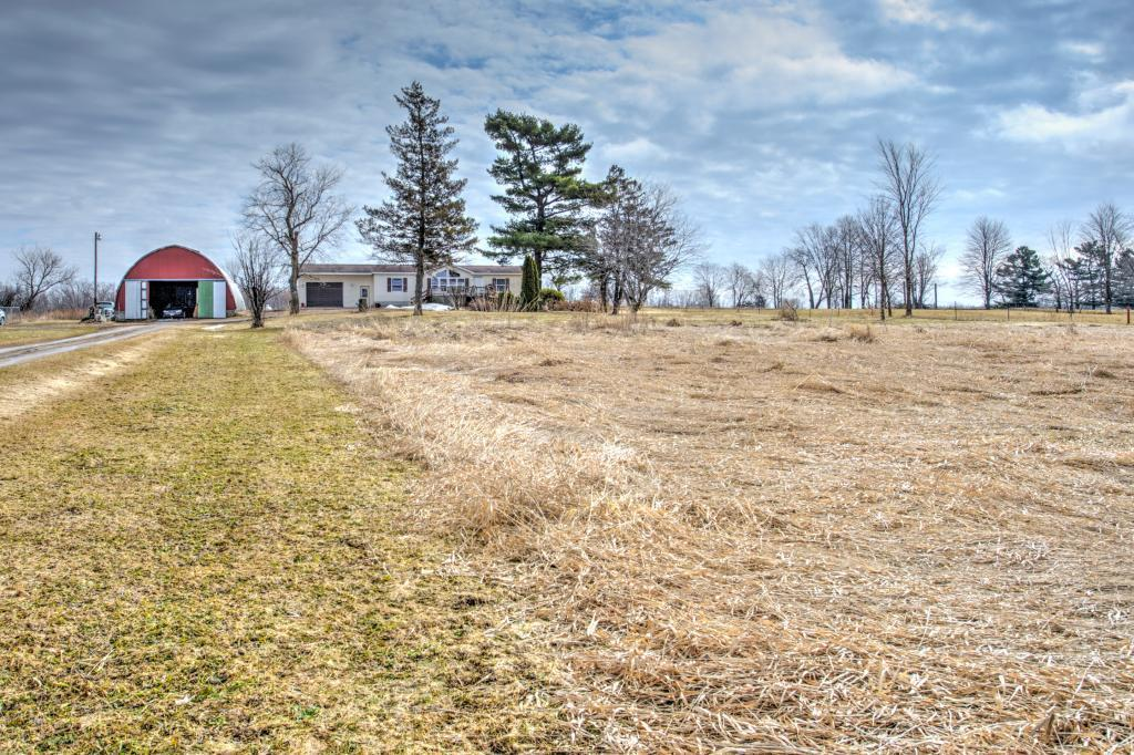 Welcome Home! 3BD/2BA one-story home on 7 acres, situated back off the road for privacy. Full basement with in-floor heat, family room and office/rec room. Home has a deck in front and out back. 30x56 Storage building. Home is priced to sell and will not last, come check out today!