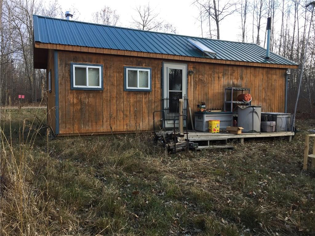 Off Grid Living - Ready for this years deer camp? Grab this one fast!  14 x 28 Amish built building.  Solar Power, Wood Stove, On demand Hot Water, Generator ready, Stands up and ready to go.  Trails groomed and deer fattened up for you.  St. Croix River landings just down the road 1.5 in one direction and 2.5 the other. Take a look today!