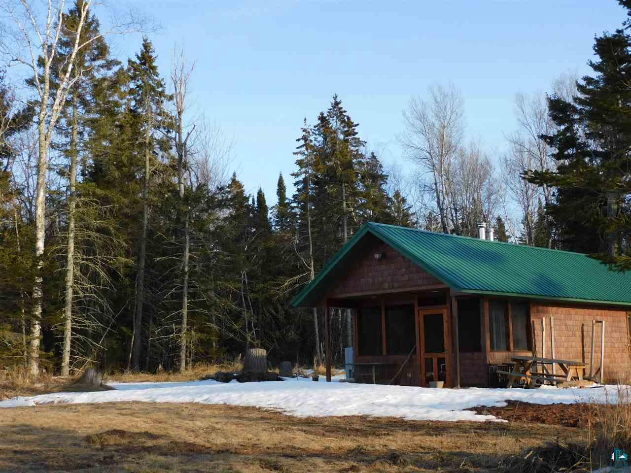 """Are you looking for that weekend getaway retreat from everyday life! """"One of a Kind"""" unique property, just waiting for you with incredible breath-taking panoramic views on Lake Superior. Private and secluded seasonal cabin with a full bathroom and a bunkhouse located on approximately 6.5 acres with 560' of Lake Superior with your own sandy beach area, and 760' of river frontage from the east bank of """"Fish Creek.""""  You have the best of both worlds fishing on the largest freshwater Lake in the world and River for fishing, canoeing, kayaking, swimming, or just walking in the water to feel the sand between your toes. Cuddling around the firepit or sitting on the picnic table with your family and friends looking at stunning sunset and sunrises lake views and watching flying eagles around you!  Seasonal cabin and bunkhouse were built in 2007, with a full bathroom, wood burning stove Sauna, Kitchen area/Living room with futon, and screened-in front porch with great views of Lake Superior. The cabin features power/lights, On-demand hot water heater, tongue and groove ceilings, dry wall, and ceiling fan.  The kids will love the bunkhouse that has a large screened-in 12X14 area below and upper area with patio doors and windows with a great views, table/desk area, top bunk bed sleeping area, power & lights. Brand new septic system 2019 , good tasting water with a private drilled well. Two options for internet by dish or fiber-optic high-speed internet service, premium channels, phone & security provided by Norvado that is available at the road.  Enjoy the shores of Lake Superior beaches and the fantastic collection of information, artifacts and family history in this area. Only a short distance from the Bark Point public boat landing and beaches, """"Siskiwit Bay Beach,"""" """"Bark Bay Slough"""" Natural Area (522 acres), also visit the quaint little village shops in Port Wing &  Cornucopia.  Located near 1000's acres of national forest and county lands, with many trails for ATV, hiking,"""