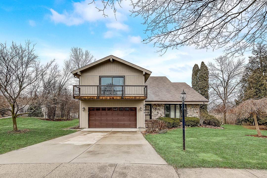 LOCATION, LOCATION, LOCATION! Close to I-94/G but free of all the traffic noise! Step outside to a multi-level Brazilian Hardwood deck that wraps around a hot tub accentuated by a waterfall and pond. This 4 BR, 2.5 bath roomy 2 story contemporary home located on a pleasant cul-de-sac. Living room has vaulted ceiling, family room with natural fireplace open to kitchen. Convenient first floor laundry. Lots of storage space throughout! Vast MBR Suite w/full bath and walk in closet. Lawn irrigation system, new appliances, and newer flooring coupled with several miscellaneous updates throughout. One-year home warranty included for additional piece of mind!!