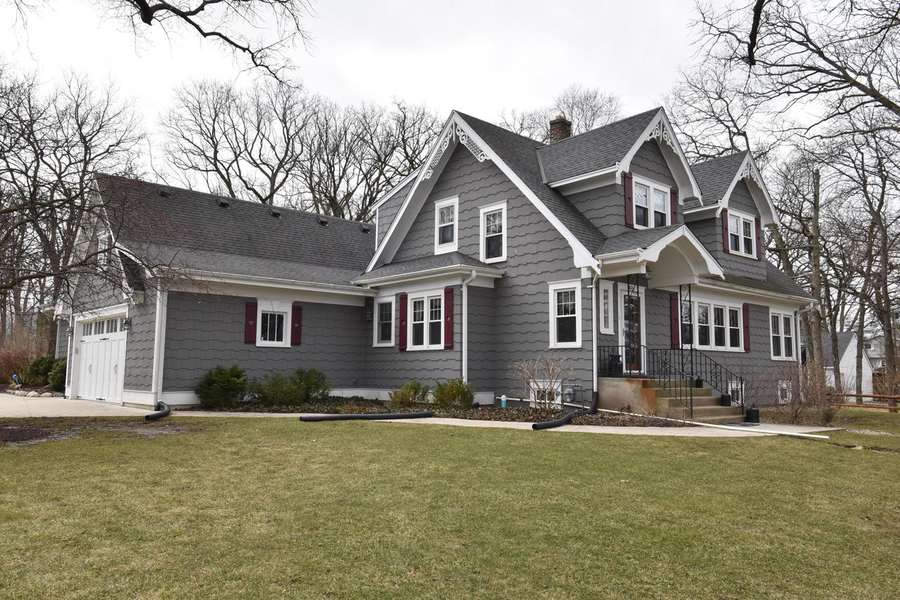 Stunning updated Cape Cod w/ cedar shake siding.In Gifford school district per RUSD map 3/23/20.Lots of beautiful wood floors & natural woodwork & custom cabinetry!Large living rm w/ crown molding & a sunny den/office/exercise rm. Formal dining rm w/ crown molding.Large family room w/ gas fireplace, wood floors.1st floor master suite has radiant heat floors, private bath w/custom stone shower, jetted tub, washer/dryer, WI closet, no AC. Large kitchen offers loads of storage w/pantry & butler's pantry, custom cabinetry, dinette has corner china cabinets. 2nd floor has 2 bedrooms, full bath w/ jetted tub, large storage closet. LL offers rec room, another laundry, full bath, office/bedroom. Fenced in area perfect for children or pets. Newer windows throughout.Private well for outside use only