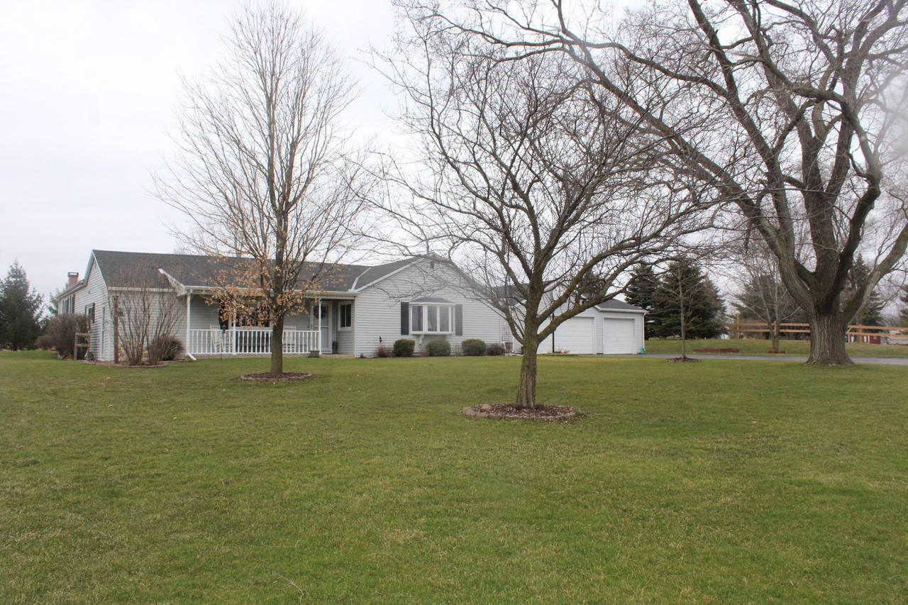Beautifully maintained Ranch on 1.25 acres in Gifford School District!  Great floor plan includes a spacious Eat-In Kitchen w/Oak Cabinets, large Living Room w/Bay Window & Master Bedroom w/Dual Closets!  Gleaming Hardwood floors enhance the Family Room w/Natural Fireplace & includes patio doors that lead out to backyard! Convenient 1st floor laundry! 2 addt'l bedrooms, Den & 2 baths complete this desirable home. Clean Basement is perfect for storage & offers finishing potential for a rec room!  Enjoy the convenience of a 3.5 car garage!  Expansive lot...covered front porch...quiet, rural location!  Call today for a private showing!