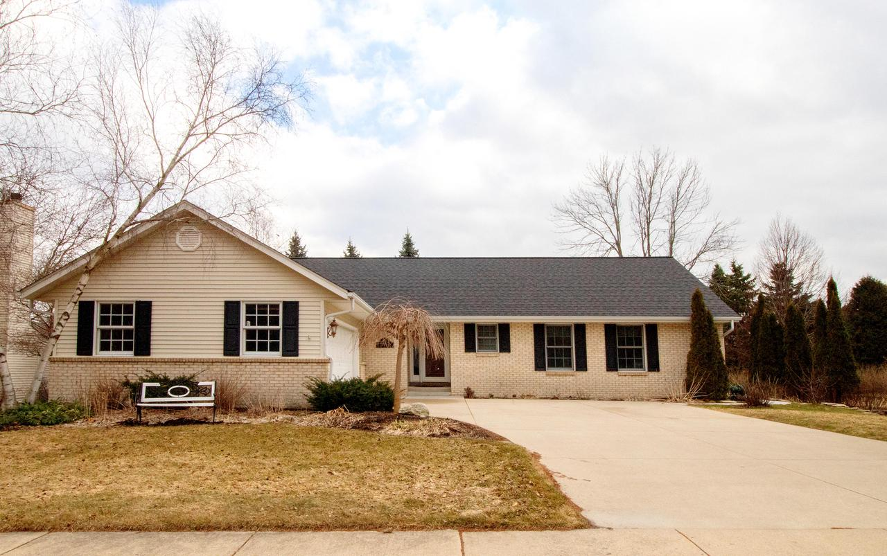 Custom built ranch home in the heart of picturesque downtown Cedarburg. Enter the foyer with stunning hard wood floors proceeding to a spacious living room with beautiful gas fireplace. Connecting with dining room featuring crown molding which extends throughout most of the home. Kitchen boasts double ovens, new refrigerator('18) and lots of storage space. Relax in the vaulted sunroom and enjoy the beautifully landscaped yard. Sliding doors connect with large composite deck for your summer grilling. Master suite with large WIC, separate soaking tub and walk in shower. Main floor laundry, second bedroom and full bath. You'll love the quality construction and amazing location.  Great condo alternative walkable to schools, parks and historic downtown Cedarburg. https://youtu.be/6pSqyuGKw1o