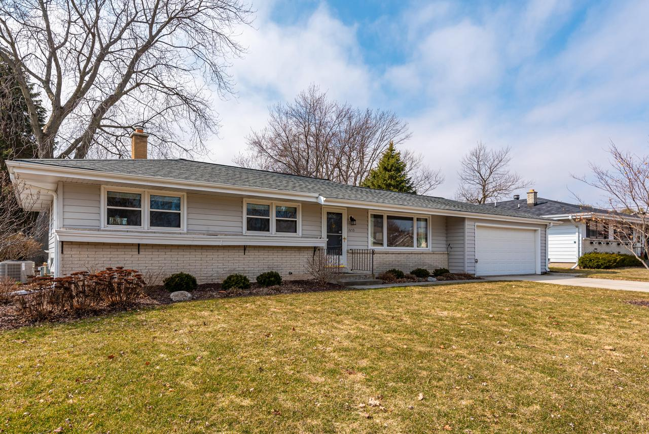 Pride of Ownership is evident throughout this well maintained gem & loaded with amenities galore! This home has it all - Newer roof, windows,siding,flooring,exterior doors, newer furnace & water heater. Newer Kitchen with updates, Island,beautiful cabinets w/custom features,microwave & dishwasher (2019), Great Rm w/impeccable HWF's,  updated Bathroom w/skylight, vanity, tile tub surround & fixtures.  HWF's in bedrooms under carpet, custom blinds & more!  Enjoy relaxing or entertaining in the gorgeous finished Recreation Room in lower boasting decorative epoxy floor, custom bar including wet bar plus refrigerator.  26' x 18' deck overlooks a beautiful, private backyard featuring garden shed and raised garden bed.  Super location close to schools, shopping and park.   This is a turnkey gem!